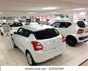 Europe UK Bedfordshire Clapham December 2018. Inside car dealership. Range of white new model cars in showroom display.