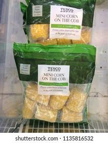 Europe UK Bedfordshire July 2018. Inside frozen food section in major supermarket. Small frozen sweetcorn cobs in plastic bag.