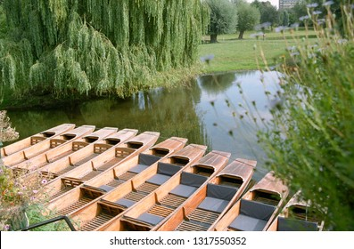 Europe UK Cambridgeshire Cambridge July 2003. Section of the River Cam at Sheep's Green and Lammas Land. Moored punts on water. Willow trees and meadow.