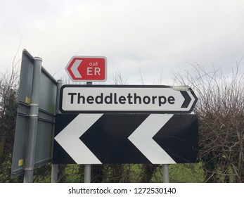 Europe UK East Lincolnshire December 2018. Emergency Route Sign. Black and white chevrons. Theddlethorpe Road Side Fingerpost