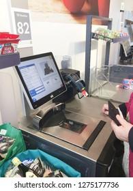 Europe UK East Lincolnshire December 2018. Inside major supermarket. Customer self service till. Scanning food items in bagging area.
