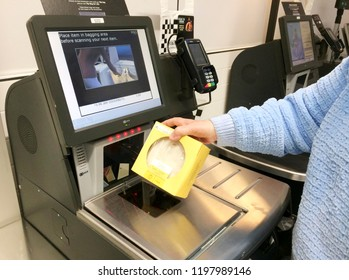 Europe UK Lincolnshire Skegness October 2018 M & S Retail supermarket. Customer self service check out till and digital bar code scanner. Woman paying for items.