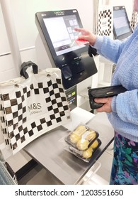 Europe UK Lincolnshire Skegness October 2018. Marks and Spencer retail supermarket. Customer at self service checkout till and digital bar code scanner. Woman paying for goods.