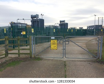 Europe UK Lincolnshire Trusthorpe December 2018. Electricity power sub station. Security warning signs with locked compound gated area.