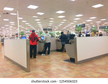 Europe UK Northamptonshire Rushden October 2017. Inside major supermarket. Customers paying for goods at self service checkouts. Scanning items using digital payment till.