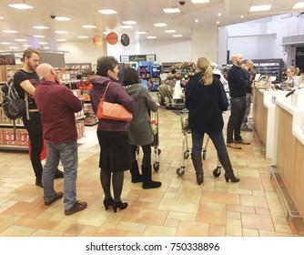 Europe UK Northamptonshire Rushden October 2017. Inside major uk supermarket at customer service desk. Queue of customers waiting to be served.