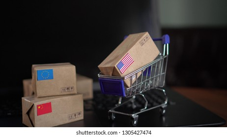 Europe, U.S. and Chinese Trade Feuding. Packing and Shipping Boxes with a National flags of China, USA an European Union