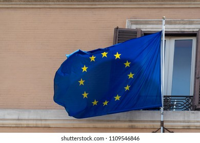 Europe waving blue gold star flag in rome