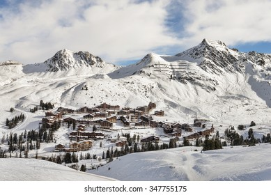 European alpine landscape of brown chalet village ski resort at winter