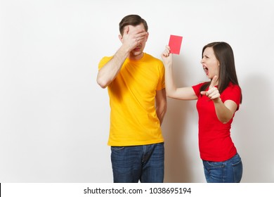 European angry aggressive young woman, football referee in red uniform show red soccer card, propose man player with soccer ball retire from field isolated on white background. Sport football concept