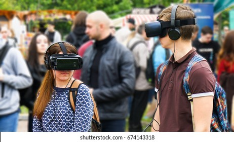 European boy and girl are testing virtual reality glasses.