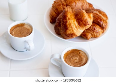 european breakfast with croissants and coffee on a light background