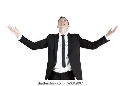 European businessman celebrating his victory by outstretched hands in the studio