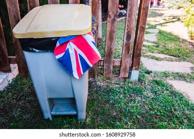 European citizens angry at Brexit throw British flag in the trash.