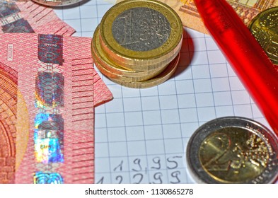 European coins and banknotes, and a ballpen for creating a calculation