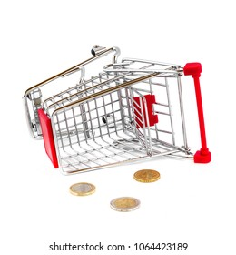 European coins with miniature shopping cart isolated on white. Cart broken and money fallen out. Business and online shopping concept image.