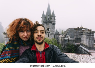 A european couple exploring an abandoned Miranda castle. Belgium (also known as Noisy Castle)