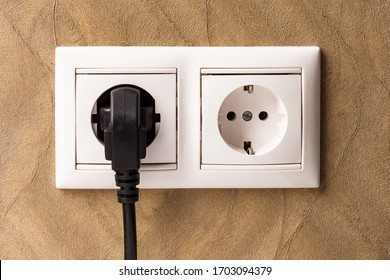 European double white electrical outlet socket, device connected .