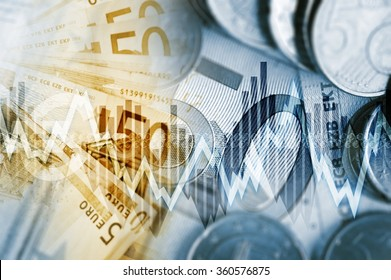 European Economy Concept. Euro Currency Fifty Euros Banknotes and Euro Cent Coins with Some Line Graphs.