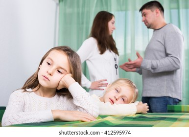 european family with two little children  having conflict at home. Focus on girls