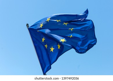 European flag in close up, in front of blue sky