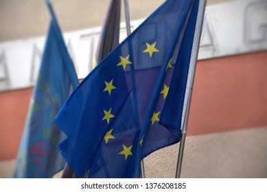 The European flag flies at the entrance of a school for Italian primary education