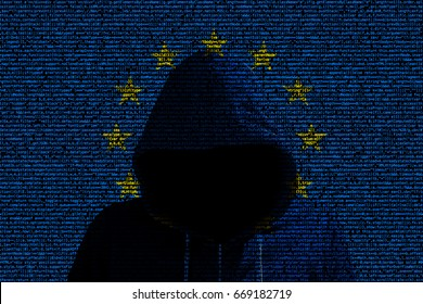 European flag made from computer code with a hooded hacker shining through cybersecurity concept