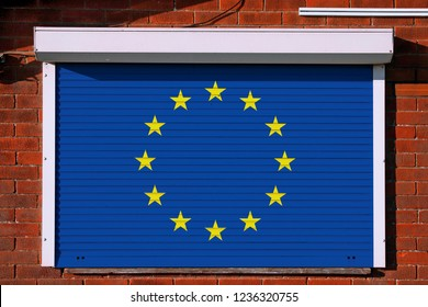 European flag on closed steel security shutters