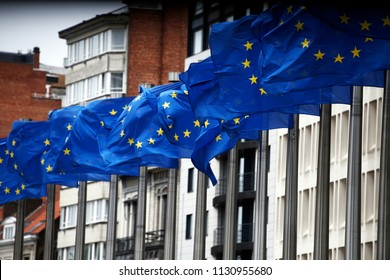 European flags flap in the wind outside EU headquarters in Brussels, Belgium on Jul. 10, 2018