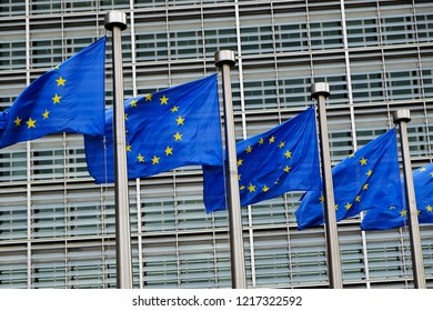 European flags flap in the wind outside EU headquarters in Brussels, Belgium on Oct. 31, 2018