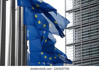 European flags flap in the wind outside EU headquarters in Brussels, Belgium on Nov. 28, 2018.