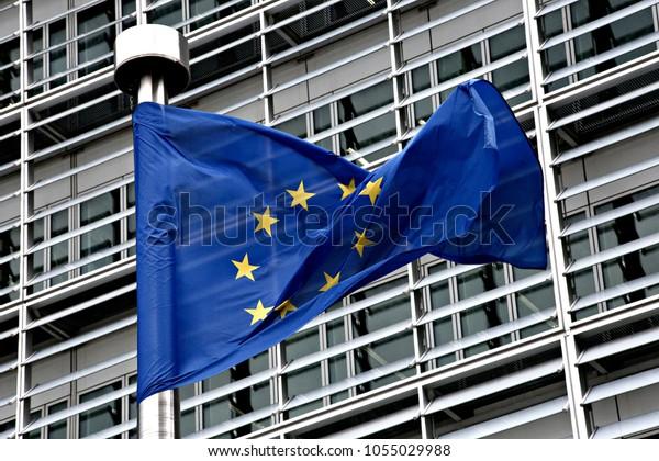 European flags flap in the wind outside EU headquarters in Brussels, Belgium on Feb. 27, 2017