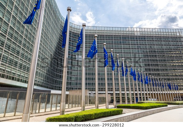 European flags in front of  headquarters of European commission in Brussels in summer day