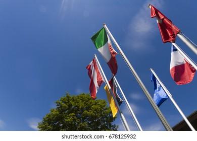 European flags waving against a clear blue sky