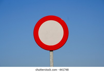 European generic forbid traffic sign. Leave it alone or fill it in with a specific speed limit. Blue sky background