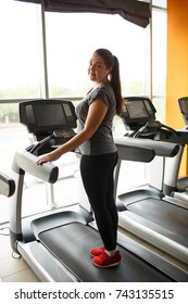 European girl in the gym alone.