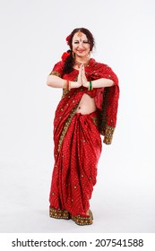 european girl in red indian saree on white background