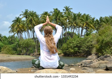 European girl relaxing on Agonda beach of South Goa, India