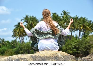 European girl relaxing on Agonda beach of South Goa, India