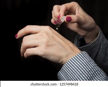 European hands of a woman with Arabian perfume oil.