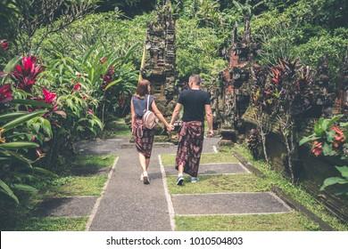 European honeymoon couple in the balinese temple area. Tropical island of Bali, Indonesia.