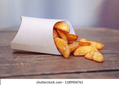 European international cuisine, fast food, french fries slices, belgian french fries in cardboard packaging