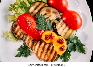 European international fusion cuisine,  beautiful dish on a white plate decorated with herbs and vegetables. a professional chef has prepared delicious meal. Vegetarian food and meat restaurant dish.