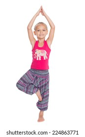 European little girl performs gymnastic exercise in Thai dress. Girl is six years old