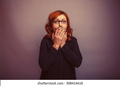 European - looking  woman 30 years  his hands over his mouth retro