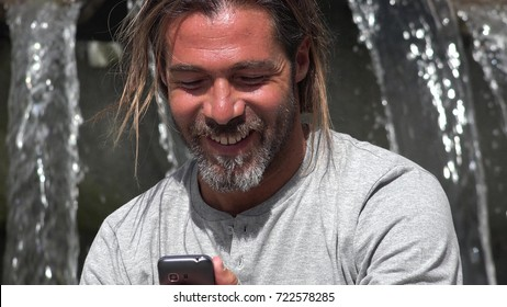 European Male Talking On Phone
