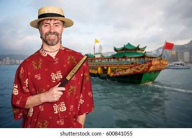European man in a traditional Chinese costume against the background of Hong Kong