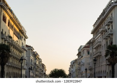 European medieval city symmetry buildings alley way promenade space foreshortening from below with soft color sun rise sky background with empty copy space