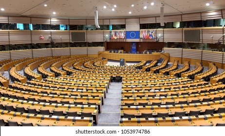 European Parliament in Brussels / Belgium / 10.11.2016 from inside emptied. A large empty hall in a massive administrative building and the flags of the EU Member States