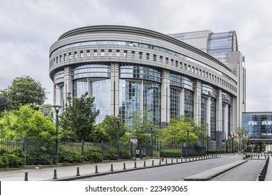 European Parliament Building and European flags. Brussels, Belgium.